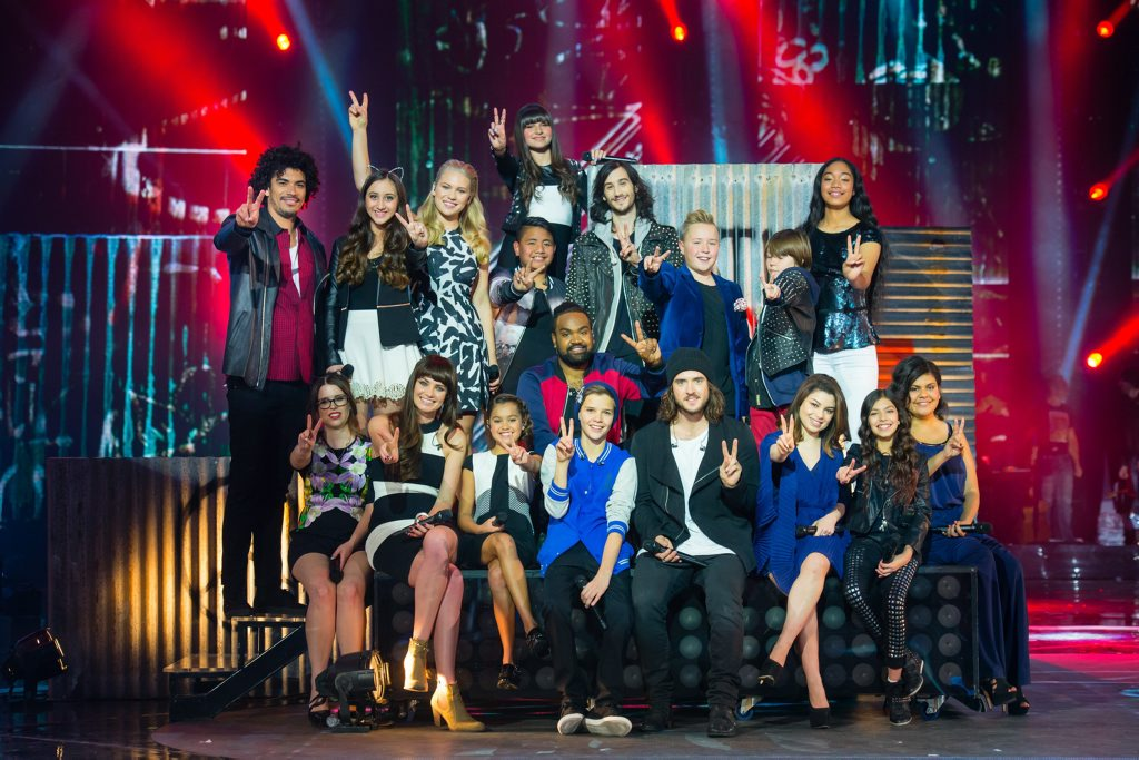The Voice's Top 8 finalists team up with singers from The Voice Kids.