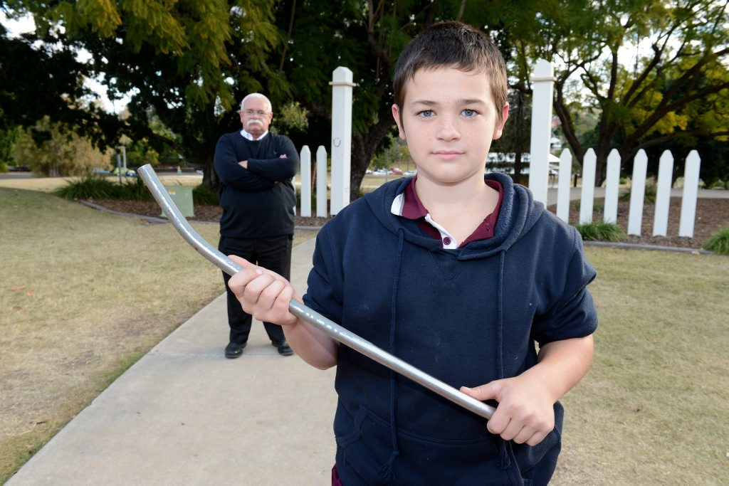 BRAVE BOY: Eleven-year-old Sam Connolly whacked a would-be thief with a metal pole when he found him in his house. Pictured with his father Ian Connolly.