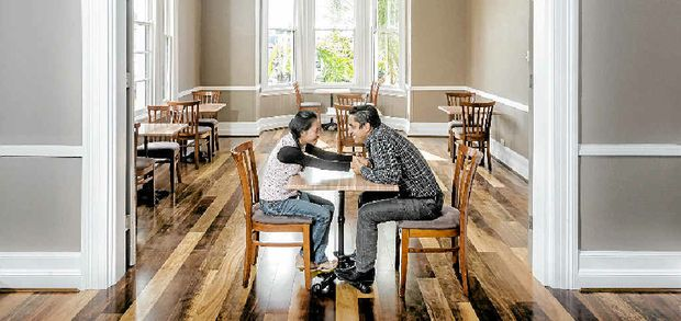 FIRM FOUNDATIONS: Shai and Tony Karouhanis inside the dining room of the newly renovated Rathgar Lodge.