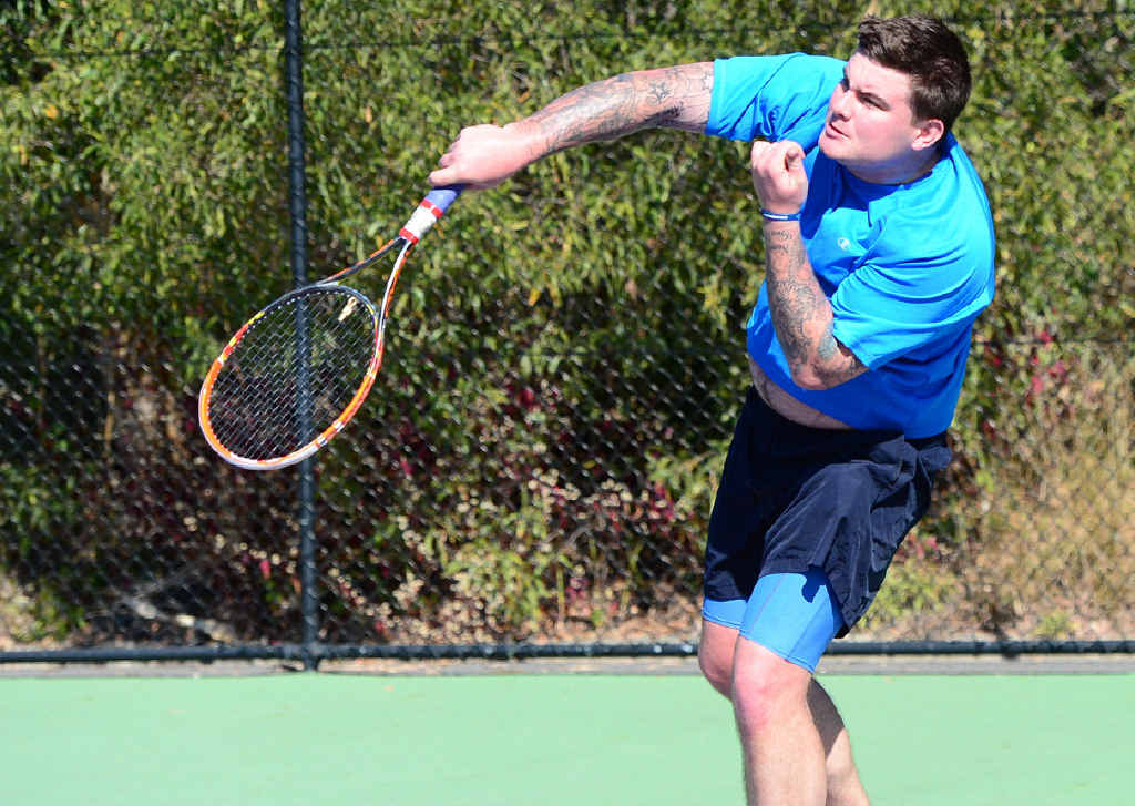 SUPER SERVE: Kurt Truelson swings into action at the Len Bauer Massage and Rejuvenation Charity Tennis Challenge, played at the Yeppoon Tennis Club on Saturday.
