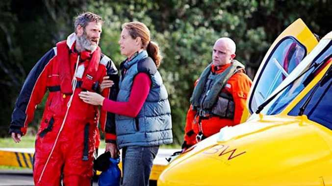 Adventurer Scott Donaldson is reunited with his wife Sarah after being rescued near the New Zealand coastline. Photo: Charlotte Curd