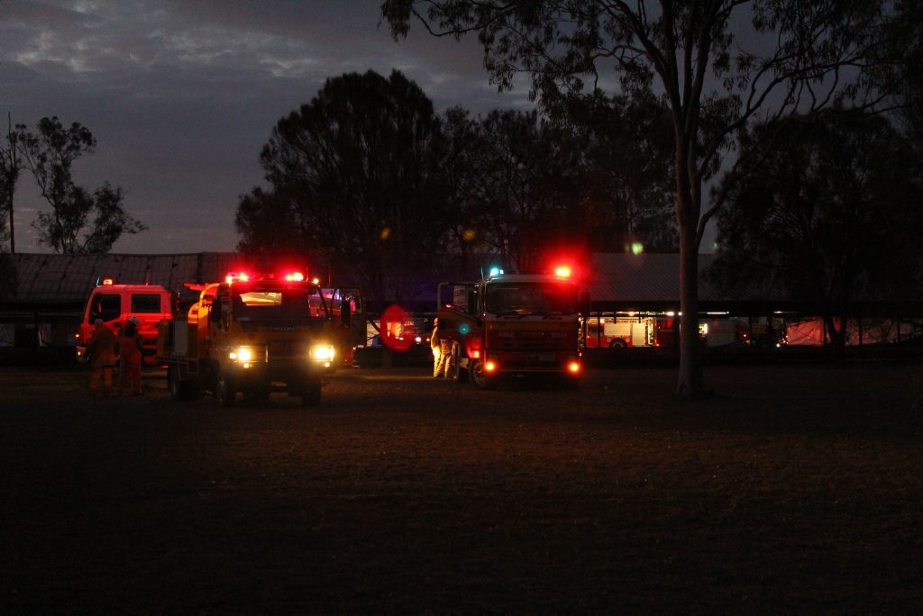 Firefighters extinguish a blaze which destroyed half of a large poultry shed at Adare, north of Gatton.