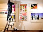 GOING UP: Dean Beletich installs a new exhibit at the Lismore Regional Gallery examining years of artistic activism.