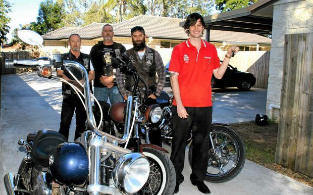 Dave Fleming, Emmett O'Brien (president) and Tim Phelps (treasurer) of the Brisbane chapter of the American Motorcycle Club and The Good Guys Morayfield team leader Alex Gillespie with the keys to the new houses.