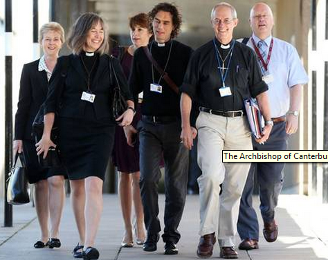 The Archbishop of Canterbury, Justin Welby, second right, and members of the clergy arrive for the General Synod meeting at the University of York