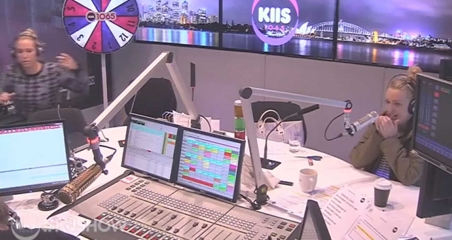 Kyle Sandilands, bottom left, vomits while on-air as KIISFM co-host Jackie O watches on