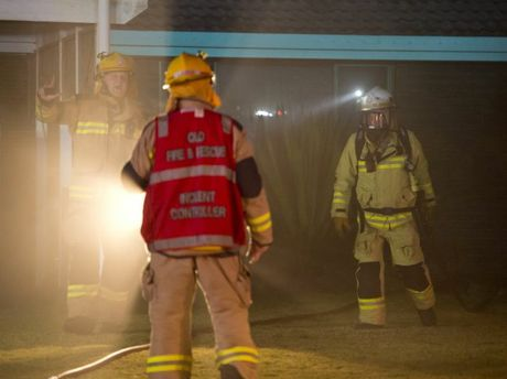 Emergency services at a Darling Heights home destroyed by fire overnight.