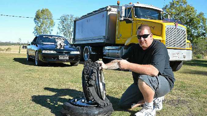 BLAZING PASSIONS: Truck driver Kimber with his two loves, his burnout ute Vicious and the tipper he drives for work.