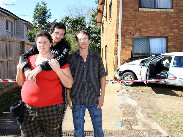 Bronwyn McLeod, Michael Moss and Jeromie Armstrong outside their damaged unit.