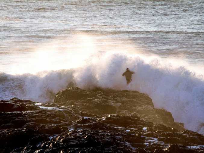 Photographer Nigel Raynard was standing on the headland at Boulder Beach early Easter Sunday when he saw two fishermen swept off the rocks at The Peg. They were saved by a passing surfer.