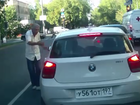 Video: BMW driver aims car at elderly man