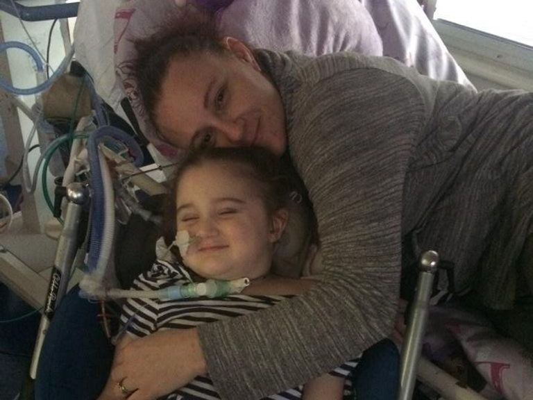 Tanya Wilkinson is able to give her little girl Abi a cuddle for the first time on Wednesday.