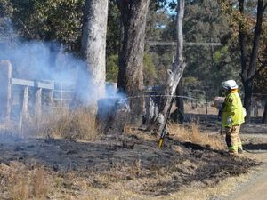 Firies battle dry, windy conditions to stop grassfire