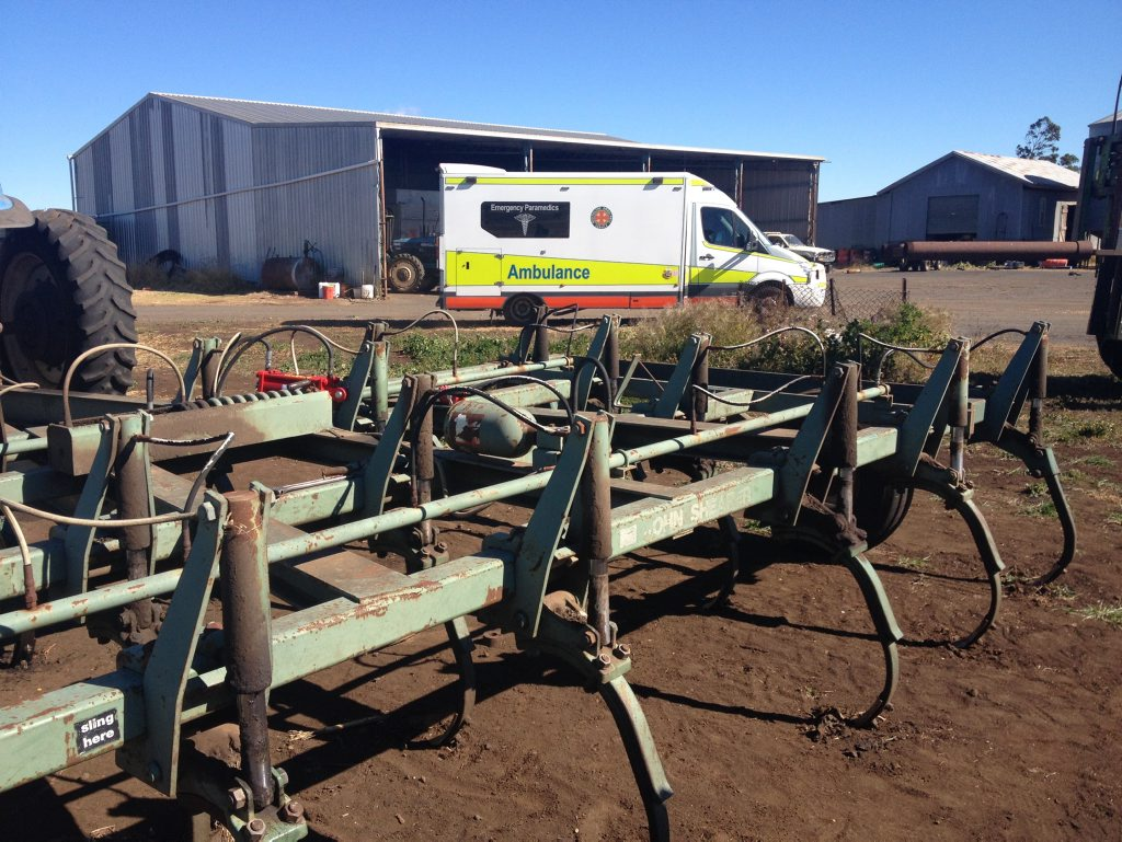 Paramedics take a 27-year-old man to hospital after a chisel plough fell across his back at a Cambooya.