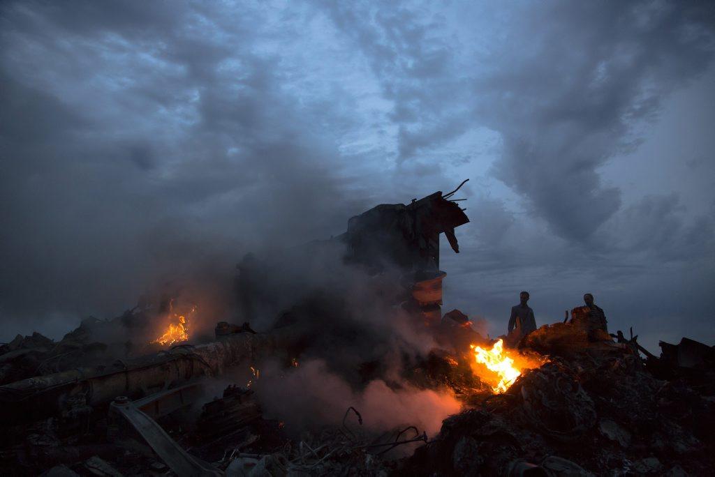 The downed passenger plane near the village of Hrabove, Ukraine, Thursday, July 17, 2014. (AP Photo/Dmitry Lovetsky)