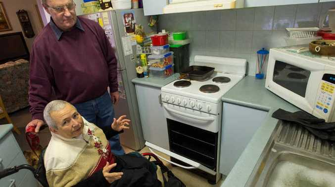 WARM RESPONSE: Eric and Sue Garvey are very happy to hear the 20-day wait they feared to have their oven repaired has shrunk to just five days. Photo: Trevor Veale