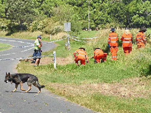 GRUESOME DISCOVERY: Police and SES officers search the area where Mr Gerbic's headless body was found off Cedar Pocket Rd. Tanya Easterby