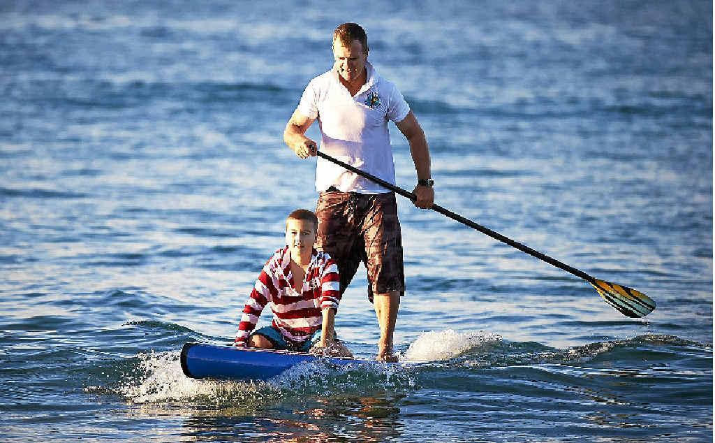LONG PADDLE: Andy Owen and 12-year-old leukemia sufferer Xavier Slezak.