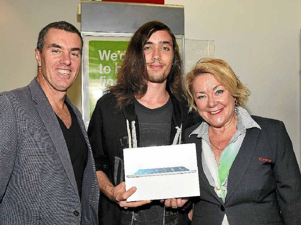 DESIGN WINNER: Ethan Bramall (centre) accepts his prize from Craig Josic and Lianne Dickson from St George Bank.