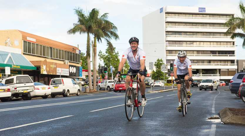 Luke Hartsuyker MP leads supporters down Coffs Harbour's Park Avenue during the 2013 charity ride.
