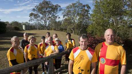Toowoomba Road Runners members (from left) Allan Jackson, Gil Barby, Anne Krause, Suzie Coleman, Shane Walsh, James Mackenzie, Mark O'Connell, Chris Gillett, Alan Bateman, Dennis Kalinowski and Greg Vincent fondly remember their club member Dr Roger Gaurd and his wife Dr Jill Gaurd at a club run.