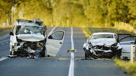 DAMAGE DONE: Police closed the Cunningham Hwy after two vehicles were involved in head-on collision at Willowbank.