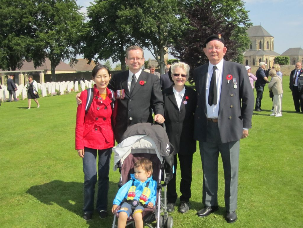 Attending the D-day remembrance service at Ranville Cemetery in June 2013 are Eriko Smith, Stephen Smith, Joan Smith, Howard Smith and Thomas Smith.