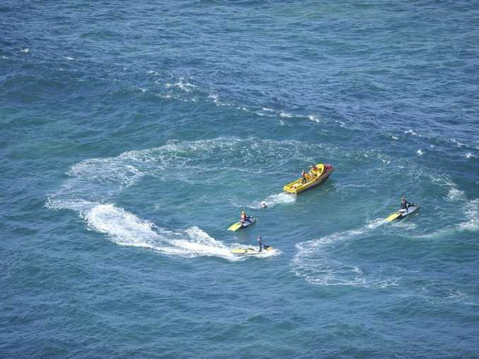 Far North Coast surf lifesaving searches for a missing surfer off the coast of Byron Bay near the Byron Bay Lighthouse after three surfers got into trouble, one remaining unaccounted for.