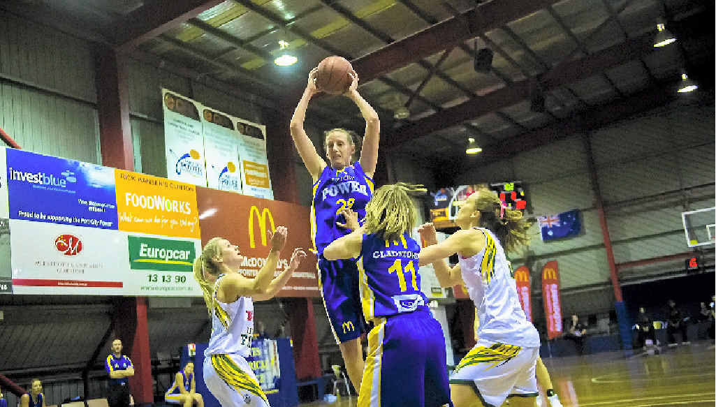 Port City's Rebecca Haynes rises over the top of everyone to claim the ball. Haynes led the Power along with Sam Norwood and Rachel Pryor as Ipswich limited the ability of Jess Bibby to hurt them on the score board.