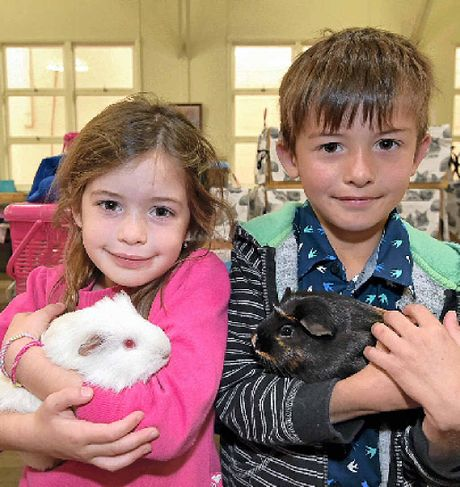 Mia Cilas, 5, with her pet, Lily, and her brother Zavier, 7, with Mischief.