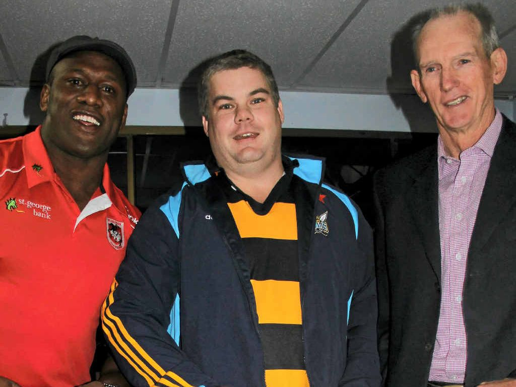 Wayne Bennett often returns to his Rose City roots for various functions, this one back in 2011 for the Cowboys flood fundraiser. Pictured also is retired Dragons winger Wendell Sailor (left) and buyer Neil McCosker.