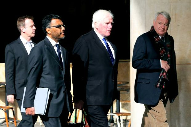 Former University of New England (UNE) chancellor John Cassidy (right) walking into the Independent Commission Against Corruption (ICAC) with Senior Council Murugan Thangaraj (2nd left) and Council Eric Oats (3rd left). Sydney, Monday, July. 21, 2014. Cassidy is accused of engaging in misconduct by tipping off a business partner about the sale of a UNE-owned property.