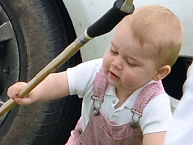 Prince George in a similar outfit to the one he was pictured in for his first royal portrait