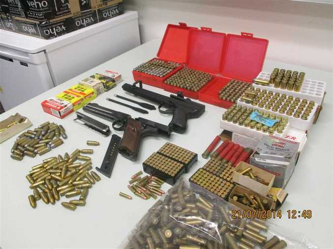 Weaponry and ammunition seized by Taskforce Maxima after a raid on Rebel bikies.