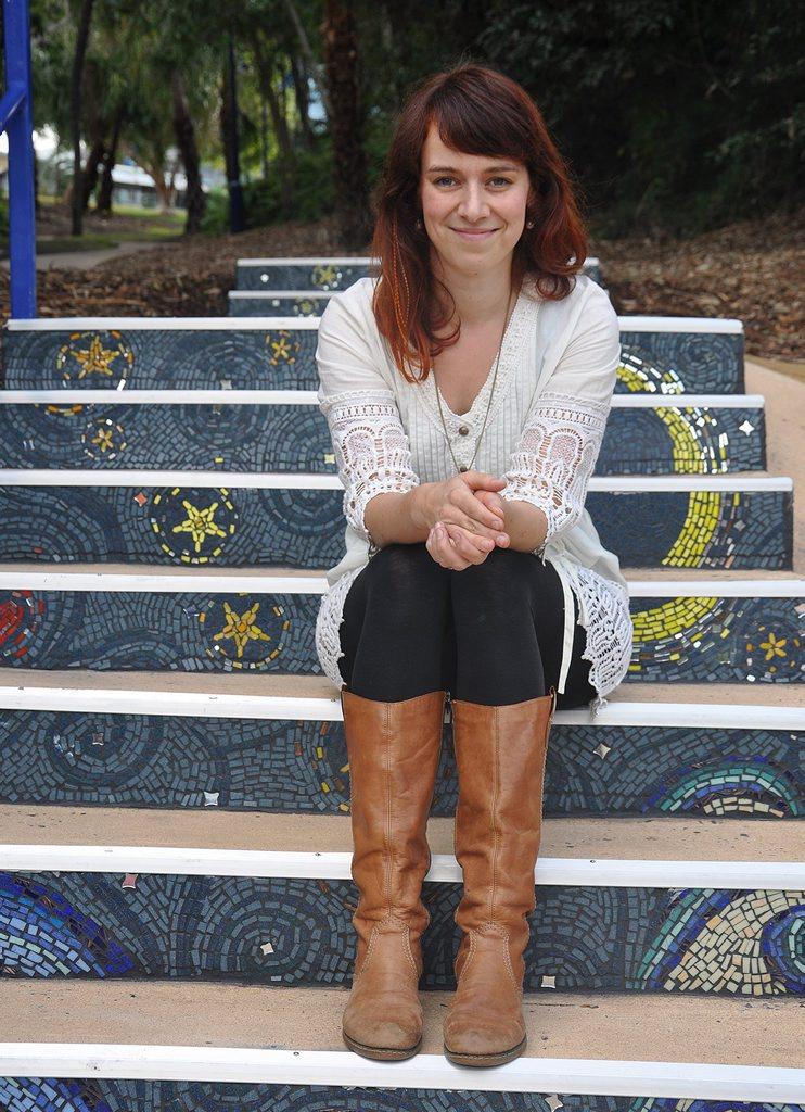 Local artist Janie Petersen with her mosaic art installation 'Moonrise', at Tannum Sands' Millennium Esplanade.