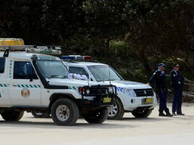 TRAGIC OUTCOME: Brunswick Valley Rescue staff and police searching along Tallow Beach, Byron Bay, on Monday after the disappearance of Stuart Butler on Saturday off Cosy Corner. The Irish surfer was still missing late yesterday.