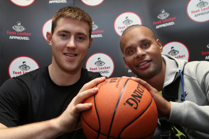 Australian San Antonio Spurs basketball stars Aron Baynes (L) and Patty Mills pose for a photograph at a publicity event in Melbourne, Tuesday, July 15, 2014. Mills is the first indigenous Australian to win the NBA championship title and he has used the break to have surgery on his shoulder.