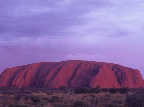 A tourist has spent the night on sacred landmark Uluru