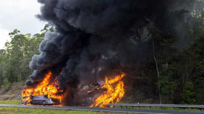 School bus fire on the Bruce Highway. Photo: Craig Burrows