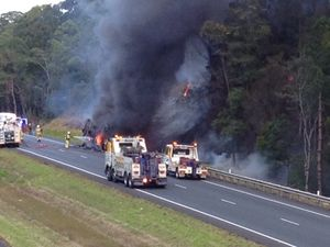 Highway reopens after school bus fire chaos