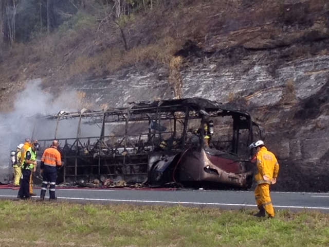 Firefighters at the aftermath of the school bus fire on the Bruce Highway.