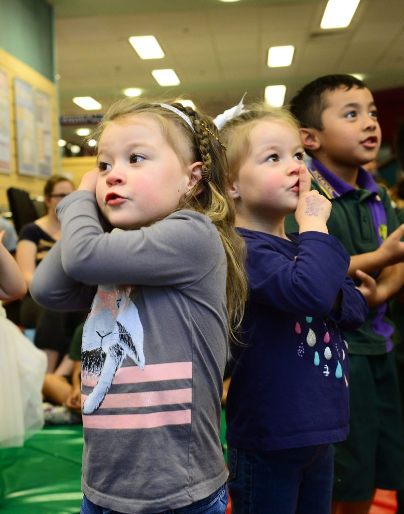 Playschool host Jay Laga'aia visited Ipswich Library to perform for a group of lucky children. Twins Lyla and Ellora Stephan, 3, of One Mile. Photo: David Nielsen / The Queensland Times