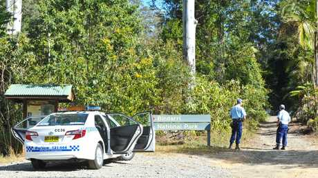 Police set up a roadblock at the entrance to Bindarri National Park near Dairyville as part of an operation to track down a wanted man.