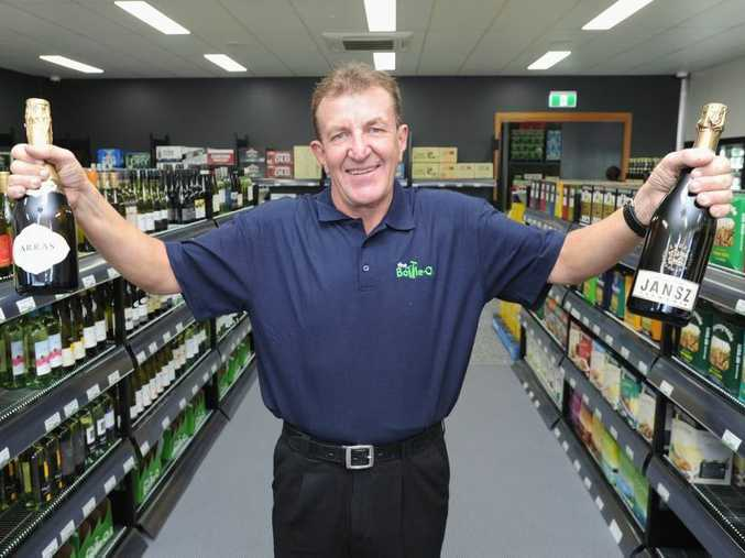 Graham Smyth at his new job in the bottle shop at the Beach House Hotel - the unemployed man had been standing beside the road with a sign looking for work for the past few weeks.