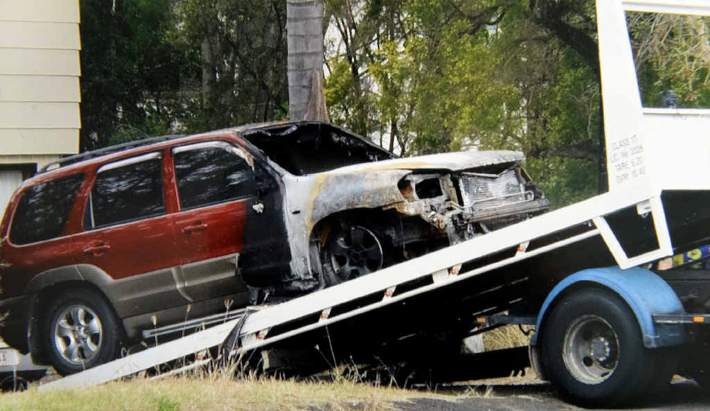 A resident in Woodend submitted these photos of a burnt out car being taken away from a suburban street. The cars were likely set alight by a towel doused in petrol and wrapped around a piece of wood Photo: Contributed