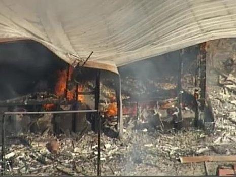 Fire engulfed the Biddaddaba home, about 45 kilometres west of Surfers Paradise Photo: Nine News
