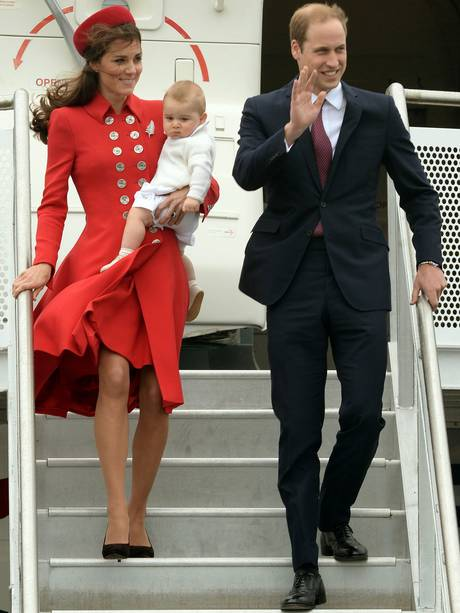 The Duke and Duchess of Cambridge get off the plane with Prince George at Wellington Military Terminal