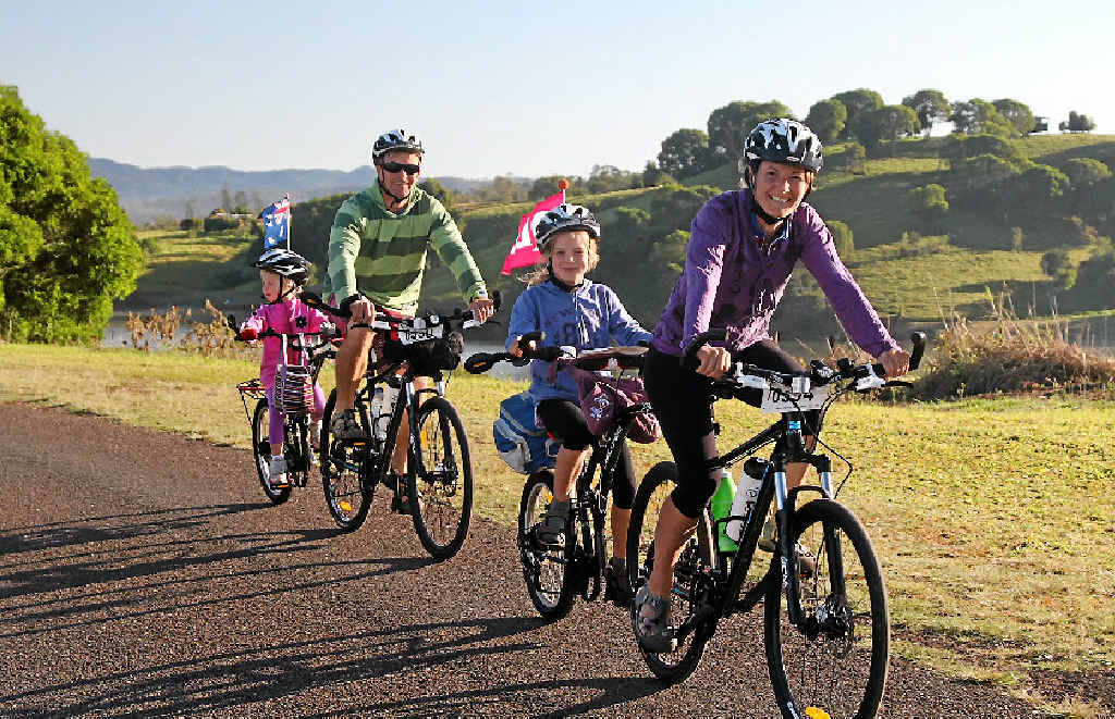 ON YOUR BIKE: A family group takes part in last year's Cycle Queensland tour of the state.