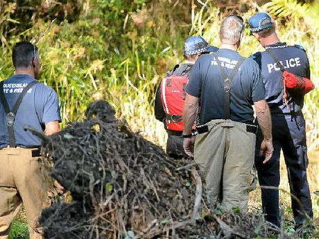 COMMITTED: Police and emergency services workers search a creek and surrounds in the hunt for clues on the murder of George Gerbic.