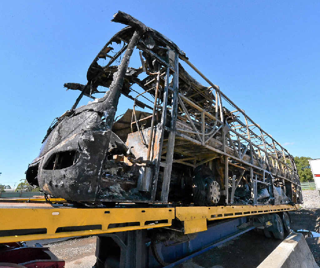 BLACKENED SKELETON: The school bus destroyed by fire sits at Clayton's Towing yard.